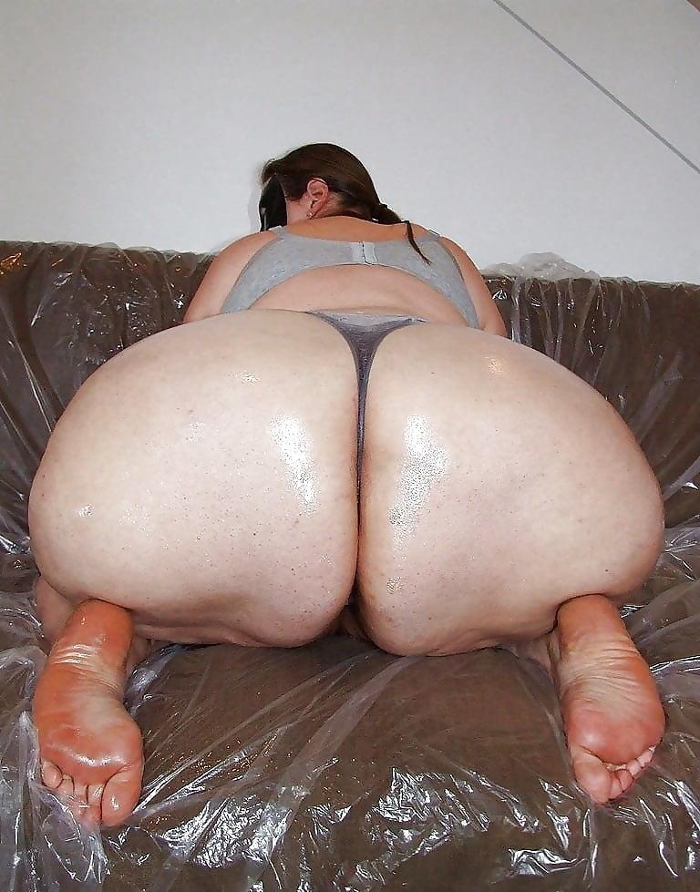 Fat ass women on beach stock photo