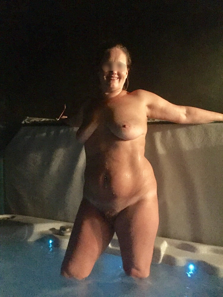 Nude wife in hot tub