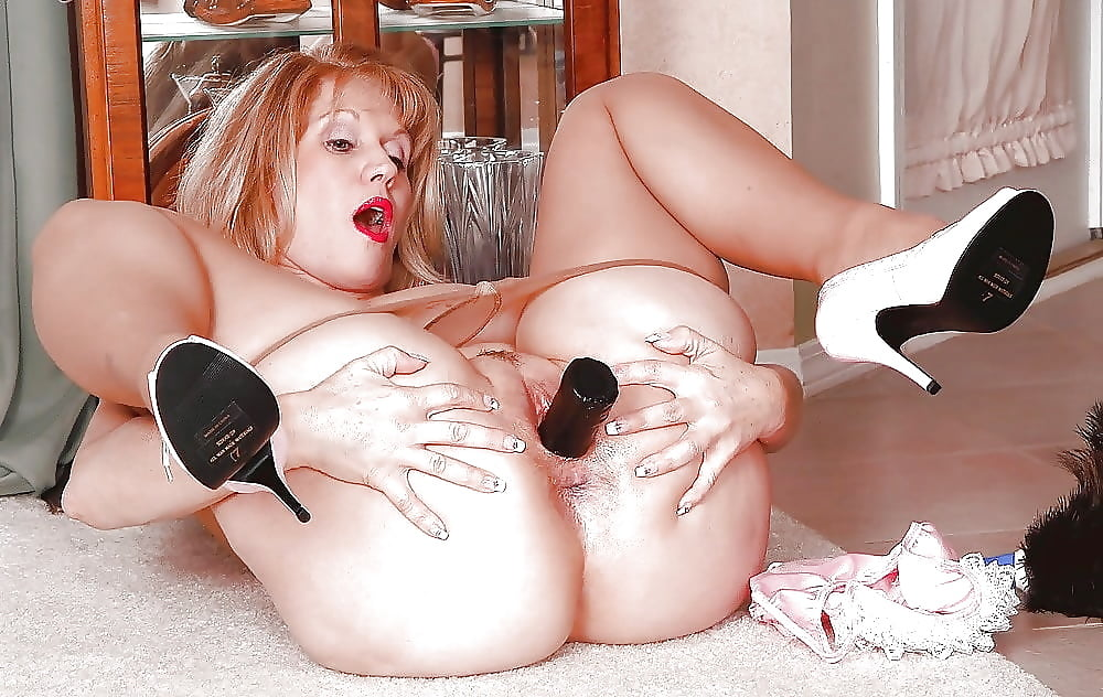 Mature Woman Playing With A Dildo