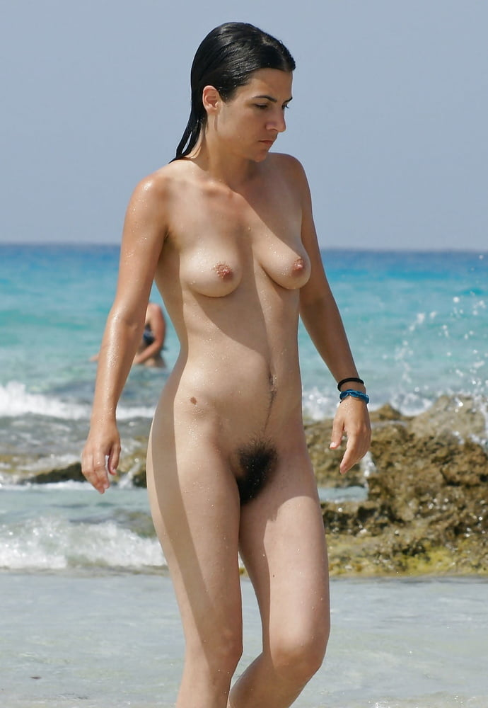 Black hair on the nude beach — img 4