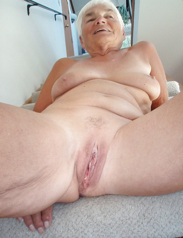 Old grandmother spreading photos