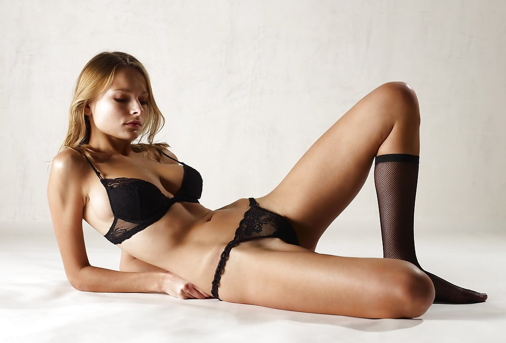 Elegant blonde in black lingerie