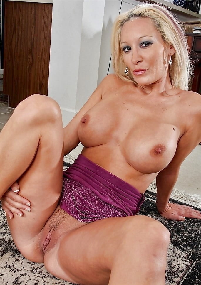 Tied up and gagged blond milf