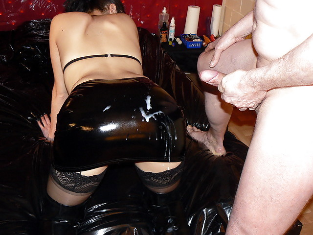Pair In Transparent And Black Latex Catsuit Have Sex And Cum In High Heels