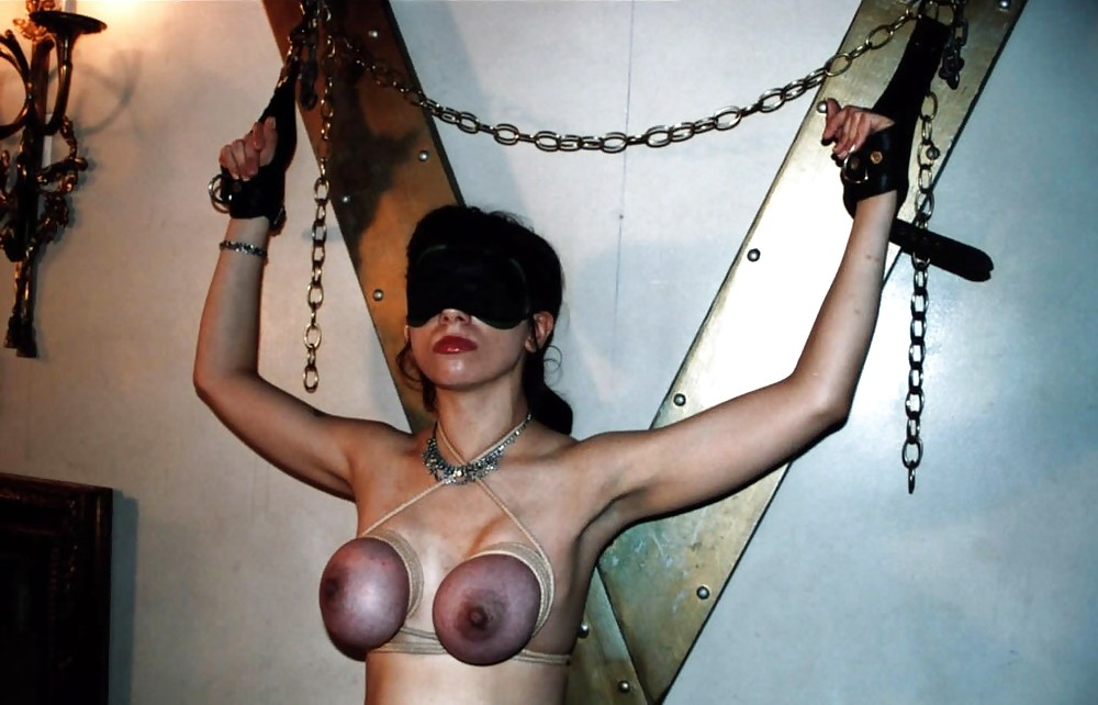 Putting naked redhead into extreme bdsm ball