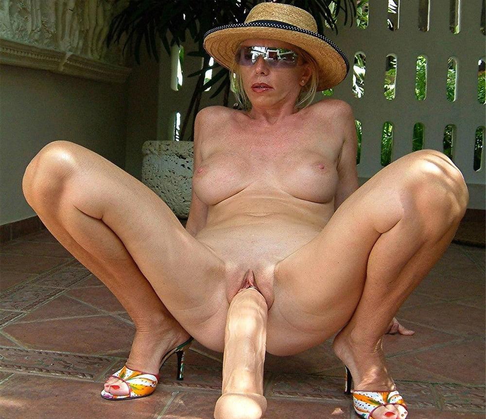 Sexy mature riding big dildo