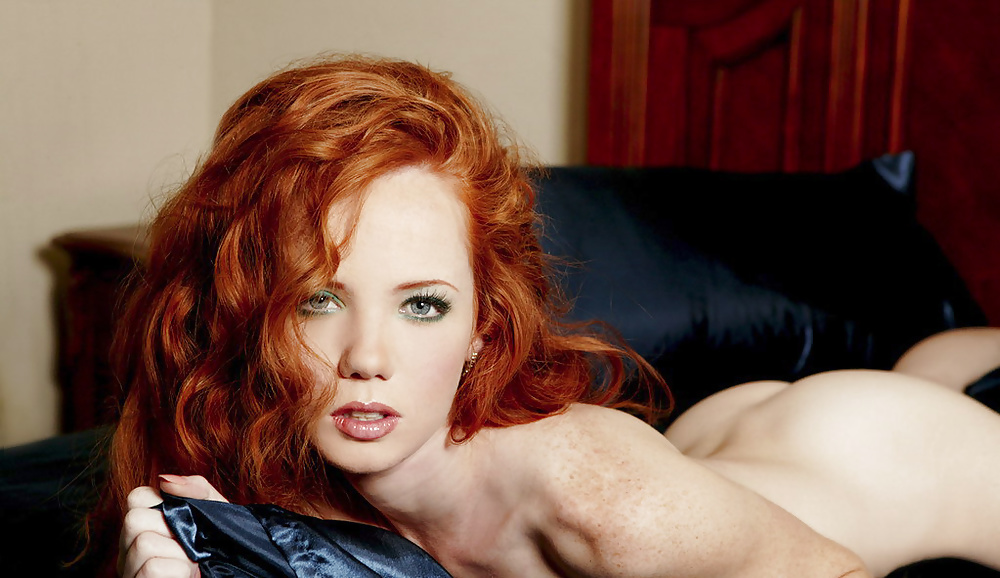 Pretty blue eyes redhead naked on a bed