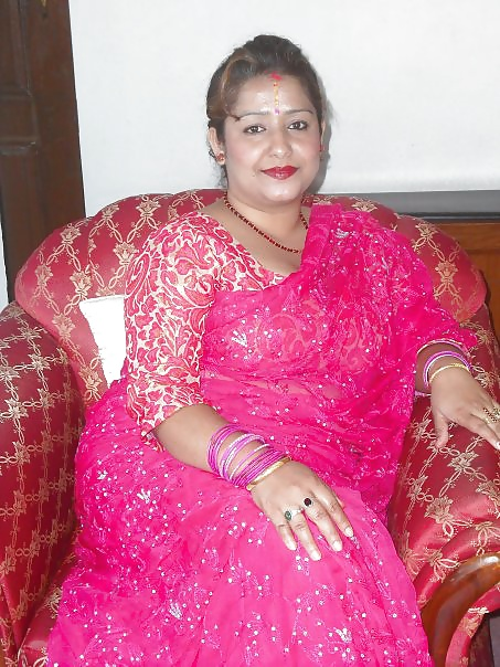 Nude in transparent saree