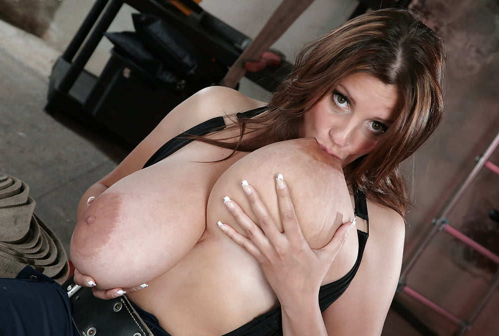 Sucking own tits