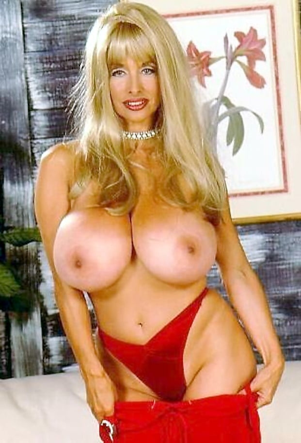 Did dolly parton ever get breast implants