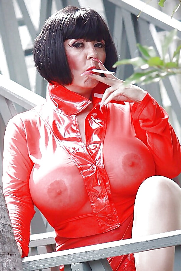 Busty Deelite Smoking Cigarettes