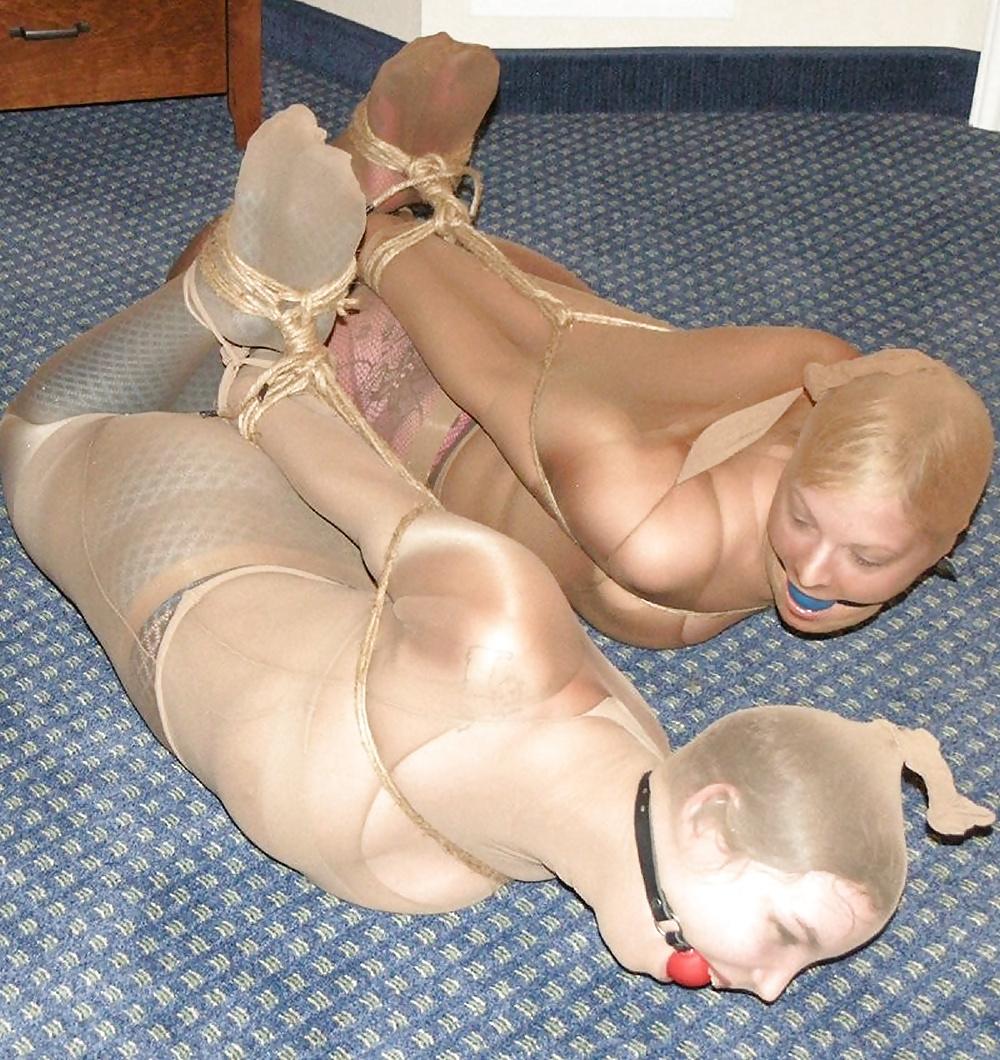 Pantyhose encasement meets strapon sex
