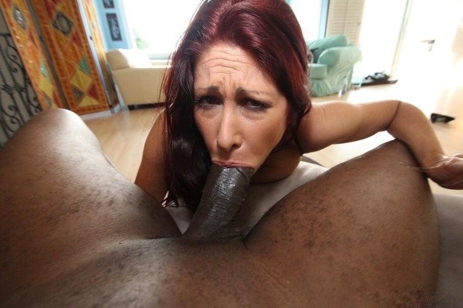 Redhead Gives Deep Throat Blowjob