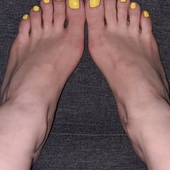 Bare Feet, Yellow Nail Polish On Her Toes