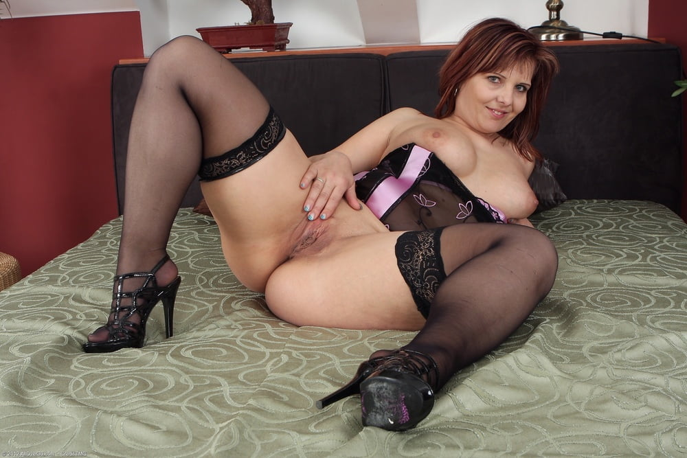 Mature sexy woman lingerie stock photo