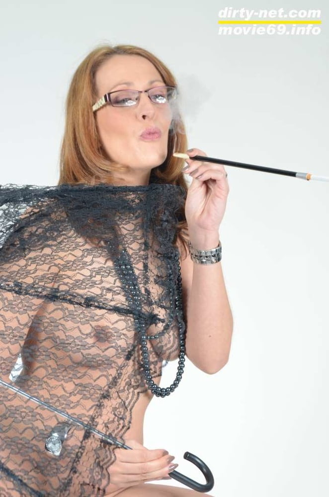 MILF Lea Blow smoking nude with a see-through umbrella