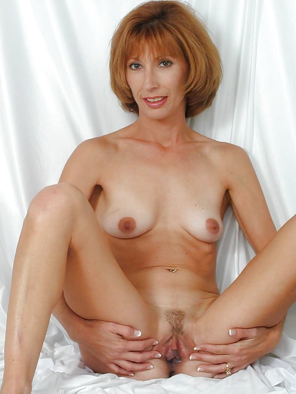 Busty slim nude mature woman 6