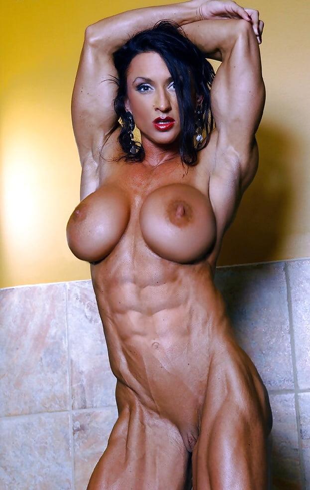 Hot naked muscular female, wet blonde pussy swollen