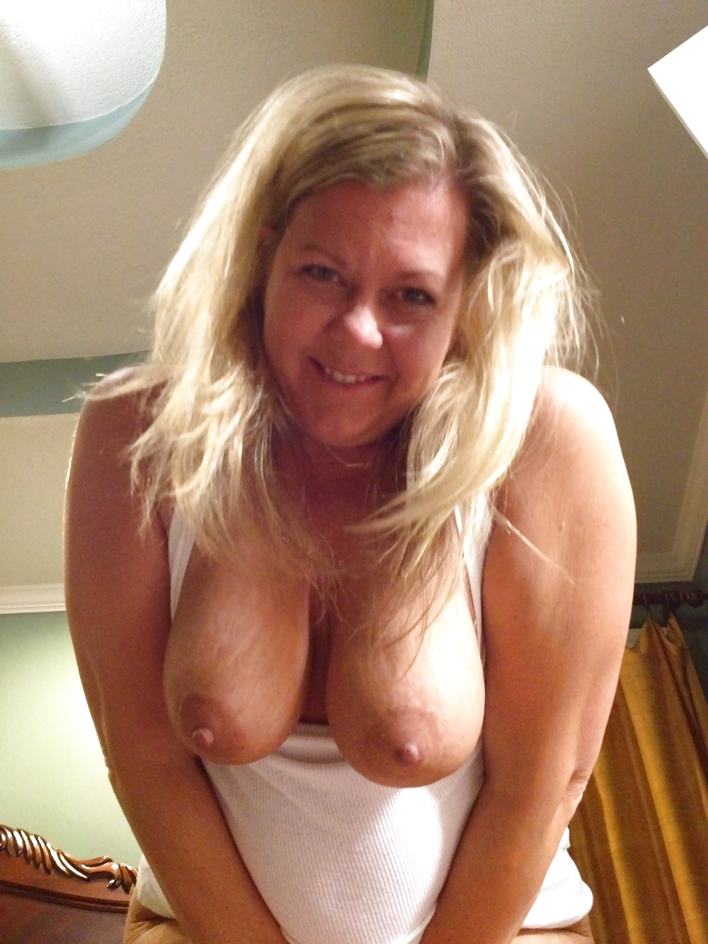 My mom showing her massive boobs