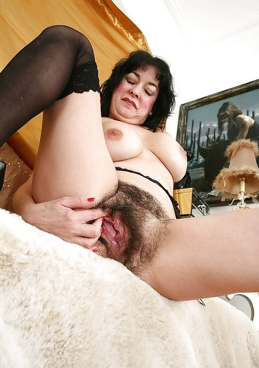 Black haired mature babe