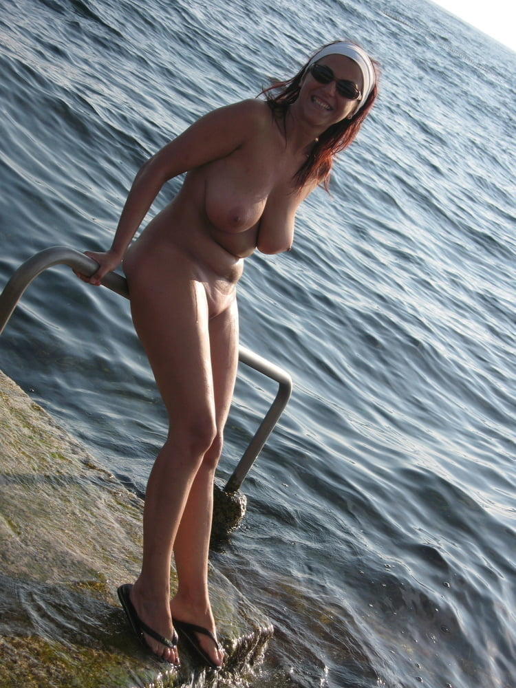 Naked on the beach: big boobs and long legs