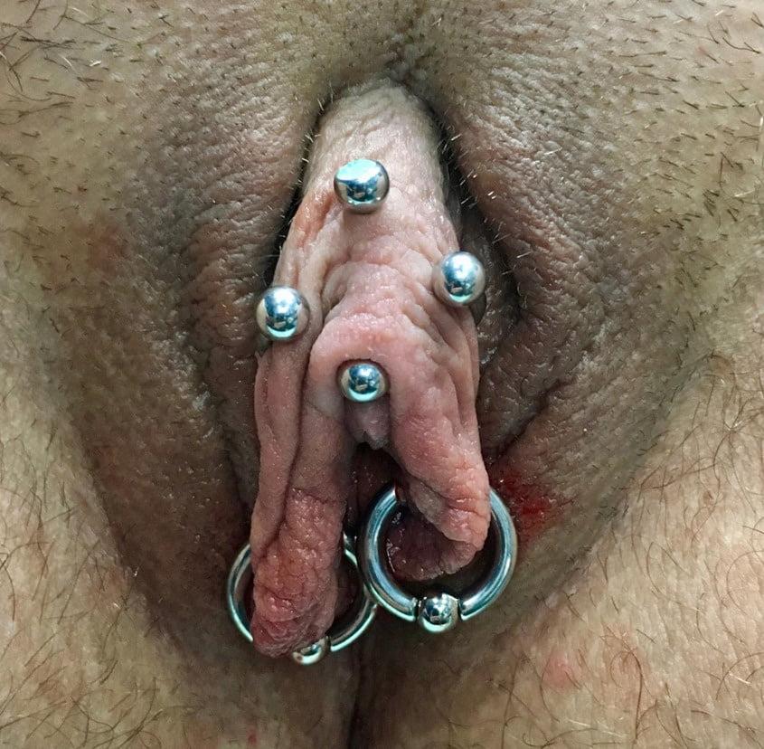 Female genital piercings artifact tattoo