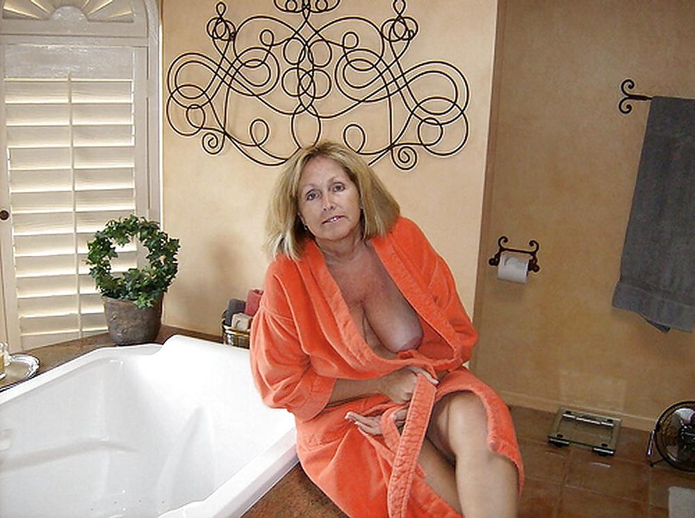 Senior Woman And Mature Man In Bathrobe Looking