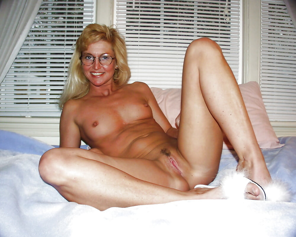 Naked white mom pictures, woman putting hands over her breasts to tease