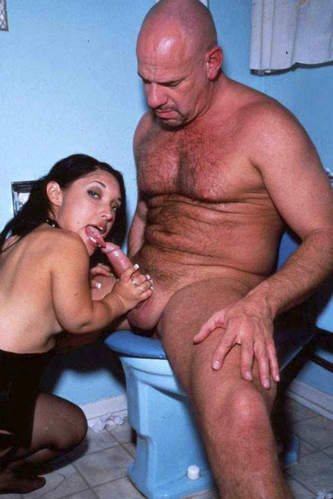 Stacie starr gives a midget a handjob until he explodes on her huge tits