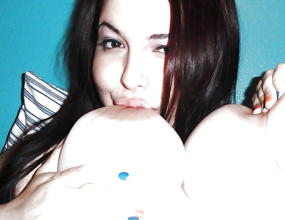 Selena sucking her boobs