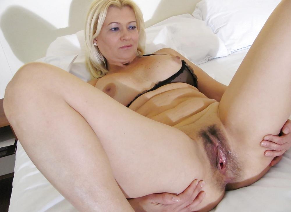 Blonde mature woman wearing a tank top, studio stock photos