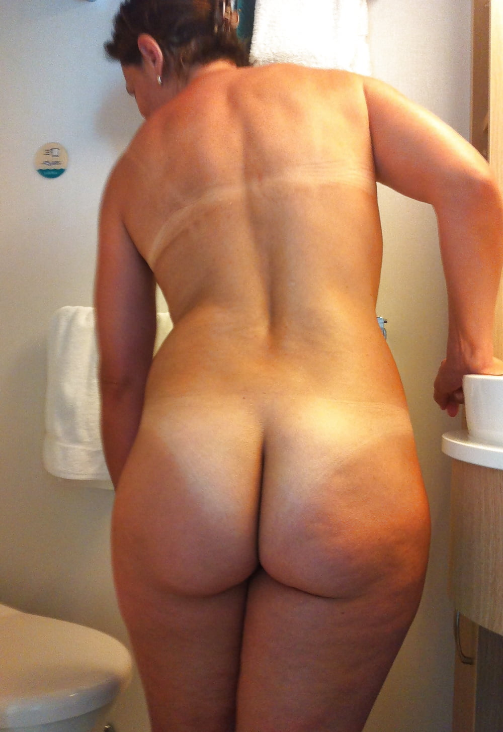 Naked big tanned ass #1