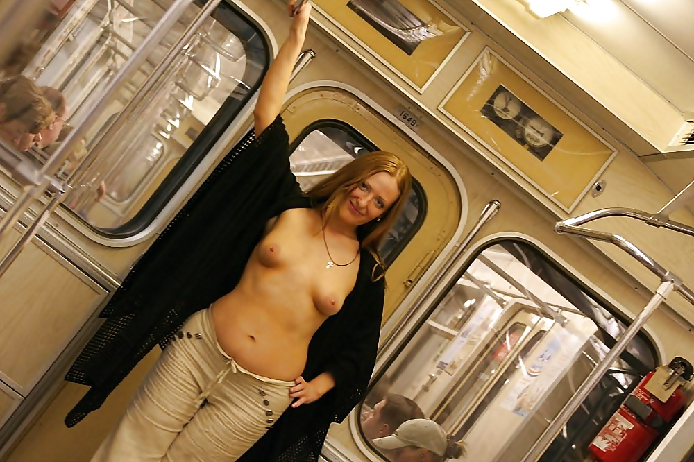 Girl boobs pressing on train