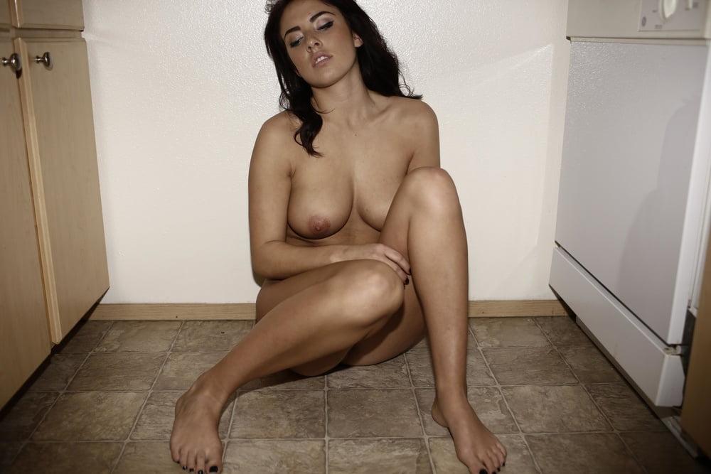 Gorgeous brunette teasing with steel dildo