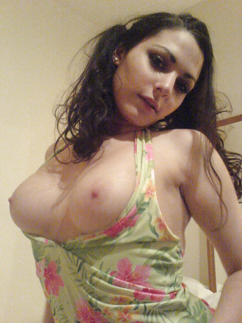 busty brunette shows off her amazings tits