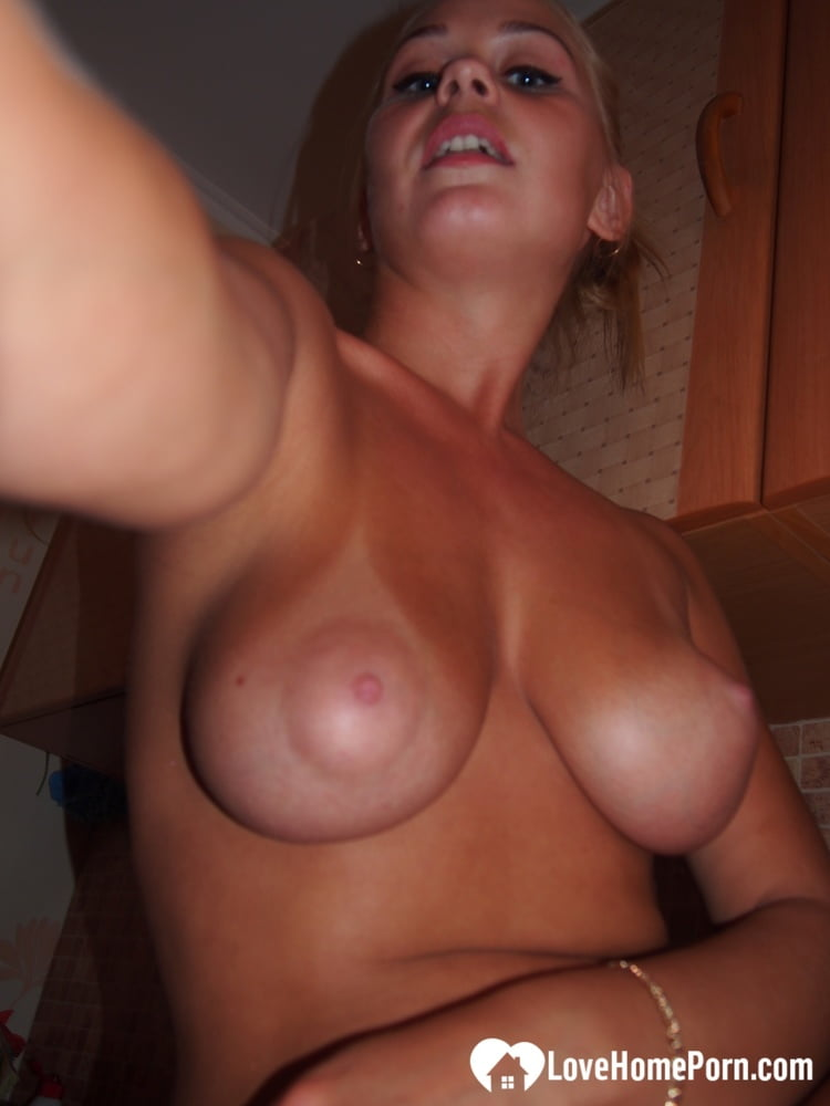 Blonde with tan lines teasing with her breasts
