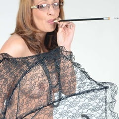 MILF Lea Blow Smoking Nude With A See Through Umbrella