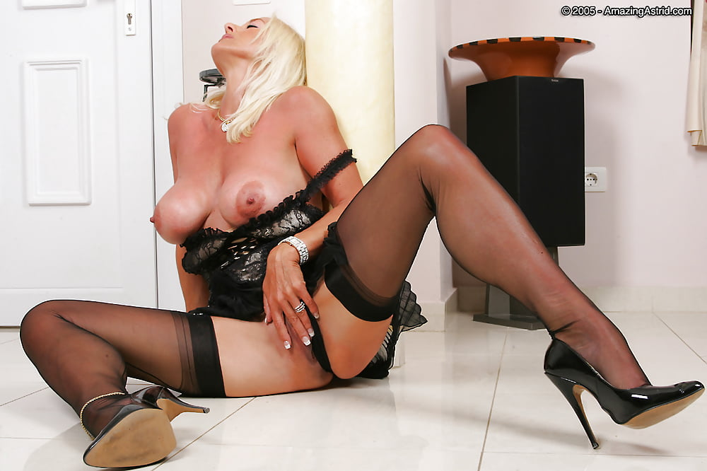 Elegant lady eve angel in sexy stockings stripping in front of camera