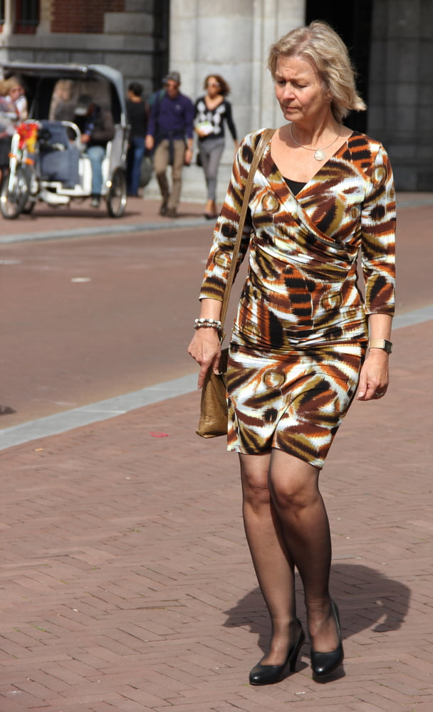 Pretty Mature Woman Wearing Grey Summer Stock Photo