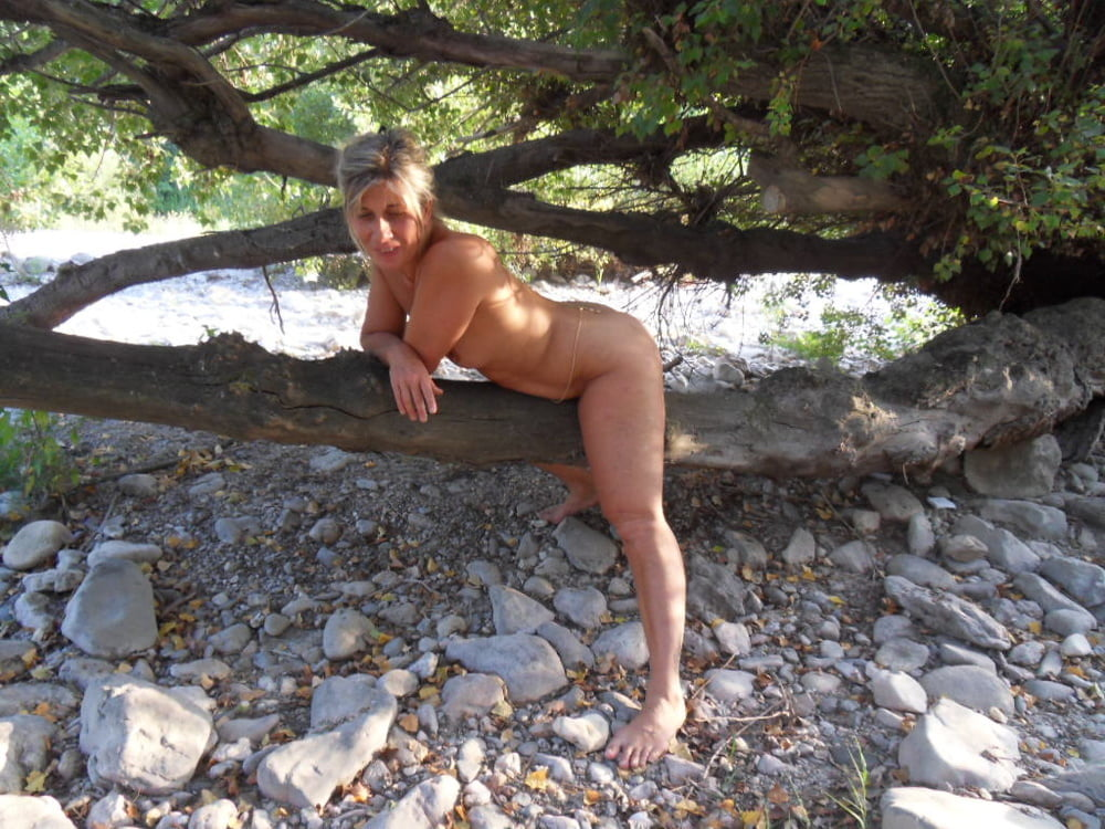 My wife naked at the beach