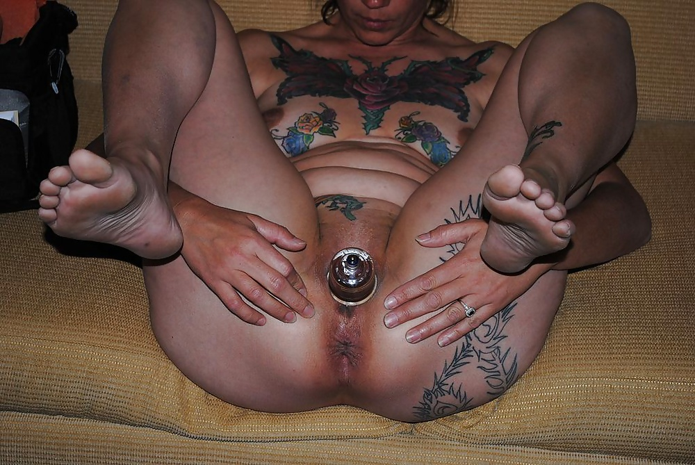 Tattooed and pierced German MILF takes a big cock