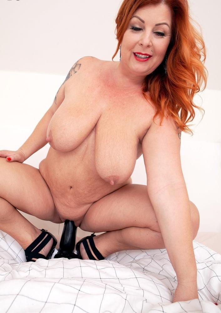 Blonde woman wearing a tight dress stock photo